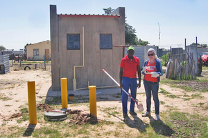 """<div class=""""bildtext_eng"""">On site in Namibia: scientist Dr. Laura Woltersdorf (right) and the operator of a wastewater treatment plant took water samples from a sewer in order to examine the water quality</div>"""