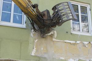 """<div class=""""bildtext"""">Rückbau eines Gebäudes</div>"""