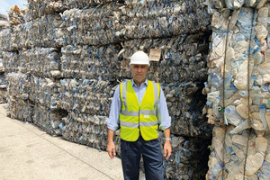 "<div class=""bildtext_en"">Ravi Chanrai (Extrupet) in front of PET bales that are waiting to be recycled</div>"
