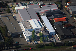 """<div class=""""bildtext_en"""">Animation of the new design: The area marked with a red line shows the planned new logistics and production halls of HERBOLD Meckesheim GmbH</div>"""